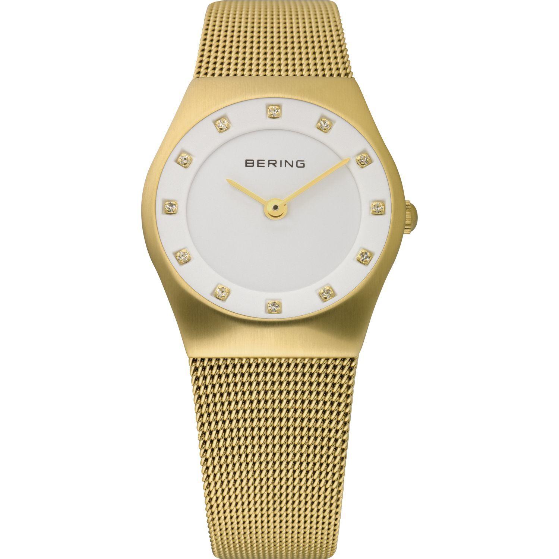 Bering 11927-334 - женские наручные часы из коллекции ClassicBering<br>женские, сапфировое стекло, корпус из нерж. стали с покрытием pvd золотого цвета ,  браслет из нерж. стали с покрытием pvd золотого цвета , циферблат белого цвета с 12-ю кристаллами swarovski золотого цвета<br><br>Бренд: Bering<br>Модель: Bering 11927-334<br>Артикул: 11927-334<br>Вариант артикула: ber-11927-334<br>Коллекция: Classic<br>Подколлекция: None<br>Страна: Дания<br>Пол: женские<br>Тип механизма: кварцевые<br>Механизм: None<br>Количество камней: None<br>Автоподзавод: None<br>Источник энергии: от батарейки<br>Срок службы элемента питания: None<br>Дисплей: стрелки<br>Цифры: отсутствуют<br>Водозащита: WR 50<br>Противоударные: None<br>Материал корпуса: нерж. сталь, покрытие: позолота (полное)<br>Материал браслета: нерж. сталь, покрытие: позолота (полное)<br>Материал безеля: None<br>Стекло: сапфировое<br>Антибликовое покрытие: None<br>Цвет корпуса: золотой<br>Цвет браслета: золотой<br>Цвет циферблата: None<br>Цвет безеля: None<br>Размеры: 27 мм<br>Диаметр: 27 мм<br>Диаметр корпуса: None<br>Толщина: None<br>Ширина ремешка: None<br>Вес: None<br>Спорт-функции: None<br>Подсветка: None<br>Вставка: кристаллы Swarovski<br>Отображение даты: None<br>Хронограф: None<br>Таймер: None<br>Термометр: None<br>Хронометр: None<br>GPS: None<br>Радиосинхронизация: None<br>Барометр: None<br>Скелетон: None<br>Дополнительная информация: None<br>Дополнительные функции: None