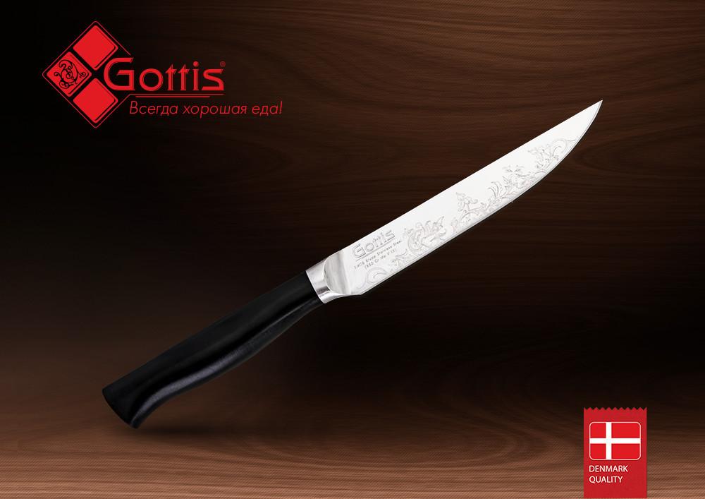 Нож кухонный стальной универсальный Gottis (арт.174)Ножи Gottis серии 170<br>Нож кухонный стальнойуниверсальный Gottis (арт.174)<br><br><br><br><br><br><br><br><br><br><br><br>Немецкая кованая сталь<br><br><br>Двусторонняя ручная заточка<br><br><br>Авторский орнамент<br><br><br>Эргономичная рукоятка<br><br><br><br><br><br><br>Gottis® - это воплощение чистоты линий современного дизайна и безупречные характеристики европейской стали. Вся продукция Gottis® произведена на современном оборудовании под контролем датских технологов, что позволяет гарантировать настоящее качество премиум-класса.<br>Нож выполнен из немецкой кованой стали1.4116 (X50 Cr Mo V 15), имеет двусторонняю ручную заточку, авторский орнамент и эргономичную рукоятку.<br>