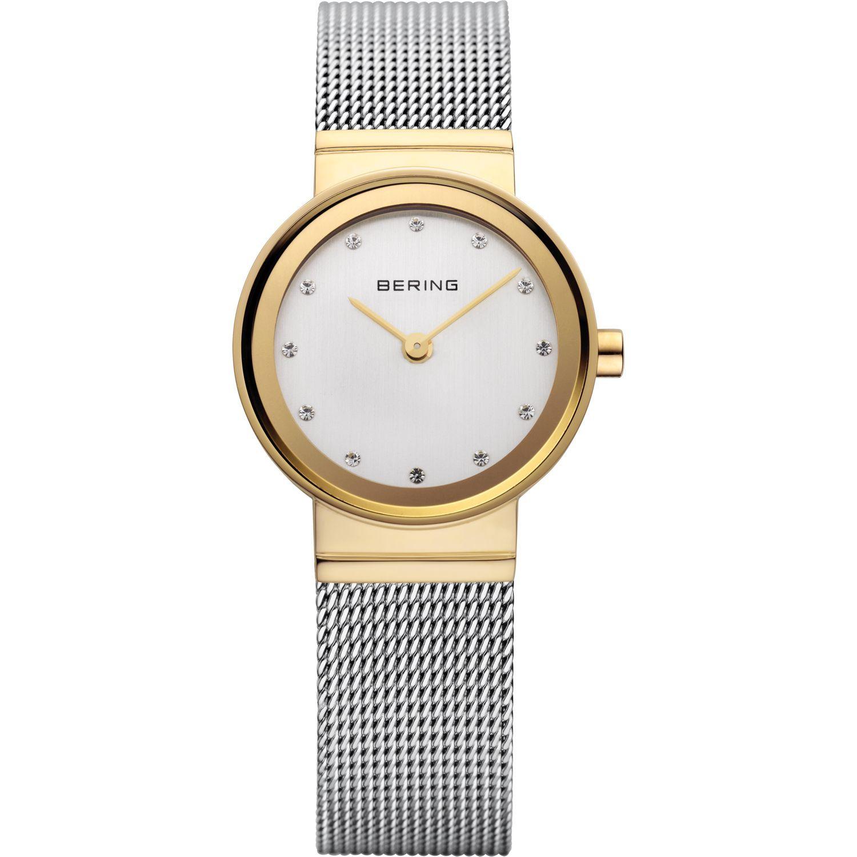 Bering 10122-001 - женские наручные часы из коллекции ClassicBering<br>женские, сапфировое стекло, корпус из нерж. стали с покрытием pvd золотого цвета ,  браслет из нерж. стали, циферблат белого цвета с 12-ю кристаллами swarovski<br><br>Бренд: Bering<br>Модель: Bering 10122-001<br>Артикул: 10122-001<br>Вариант артикула: ber-10122-001<br>Коллекция: Classic<br>Подколлекция: None<br>Страна: Дания<br>Пол: женские<br>Тип механизма: кварцевые<br>Механизм: None<br>Количество камней: None<br>Автоподзавод: None<br>Источник энергии: от батарейки<br>Срок службы элемента питания: None<br>Дисплей: стрелки<br>Цифры: отсутствуют<br>Водозащита: WR 50<br>Противоударные: None<br>Материал корпуса: нерж. сталь, PVD покрытие: позолота (полное)<br>Материал браслета: нерж. сталь<br>Материал безеля: None<br>Стекло: сапфировое<br>Антибликовое покрытие: None<br>Цвет корпуса: золотой<br>Цвет браслета: серебрянный<br>Цвет циферблата: None<br>Цвет безеля: None<br>Размеры: None<br>Диаметр: 22 мм<br>Диаметр корпуса: None<br>Толщина: None<br>Ширина ремешка: None<br>Вес: None<br>Спорт-функции: None<br>Подсветка: None<br>Вставка: кристаллы Swarovski<br>Отображение даты: None<br>Хронограф: None<br>Таймер: None<br>Термометр: None<br>Хронометр: None<br>GPS: None<br>Радиосинхронизация: None<br>Барометр: None<br>Скелетон: None<br>Дополнительная информация: None<br>Дополнительные функции: None