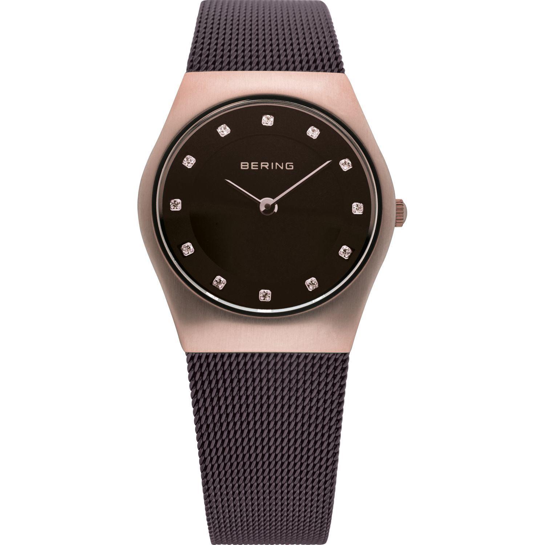Bering 11927-262 - женские наручные часы из коллекции ClassicBering<br>женские, сапфировое стекло, корпус из нерж. стали с покрытием pvd розового цвета ,  браслет из нерж. стали с покрытием pvd черного цвета , циферблат черного цвета с 12-ю кристаллами swarovski розового цвета<br><br>Бренд: Bering<br>Модель: Bering 11927-262<br>Артикул: 11927-262<br>Вариант артикула: ber-11927-262<br>Коллекция: Classic<br>Подколлекция: None<br>Страна: Дания<br>Пол: женские<br>Тип механизма: кварцевые<br>Механизм: None<br>Количество камней: None<br>Автоподзавод: None<br>Источник энергии: от батарейки<br>Срок службы элемента питания: None<br>Дисплей: стрелки<br>Цифры: отсутствуют<br>Водозащита: WR 50<br>Противоударные: None<br>Материал корпуса: нерж. сталь, покрытие: позолота (полное)<br>Материал браслета: нерж. сталь, полное дополнительное покрытие<br>Материал безеля: None<br>Стекло: сапфировое<br>Антибликовое покрытие: None<br>Цвет корпуса: розовое золото<br>Цвет браслета: коричневый<br>Цвет циферблата: None<br>Цвет безеля: None<br>Размеры: 27 мм<br>Диаметр: 27 мм<br>Диаметр корпуса: None<br>Толщина: None<br>Ширина ремешка: None<br>Вес: None<br>Спорт-функции: None<br>Подсветка: None<br>Вставка: кристаллы Swarovski<br>Отображение даты: None<br>Хронограф: None<br>Таймер: None<br>Термометр: None<br>Хронометр: None<br>GPS: None<br>Радиосинхронизация: None<br>Барометр: None<br>Скелетон: None<br>Дополнительная информация: None<br>Дополнительные функции: None