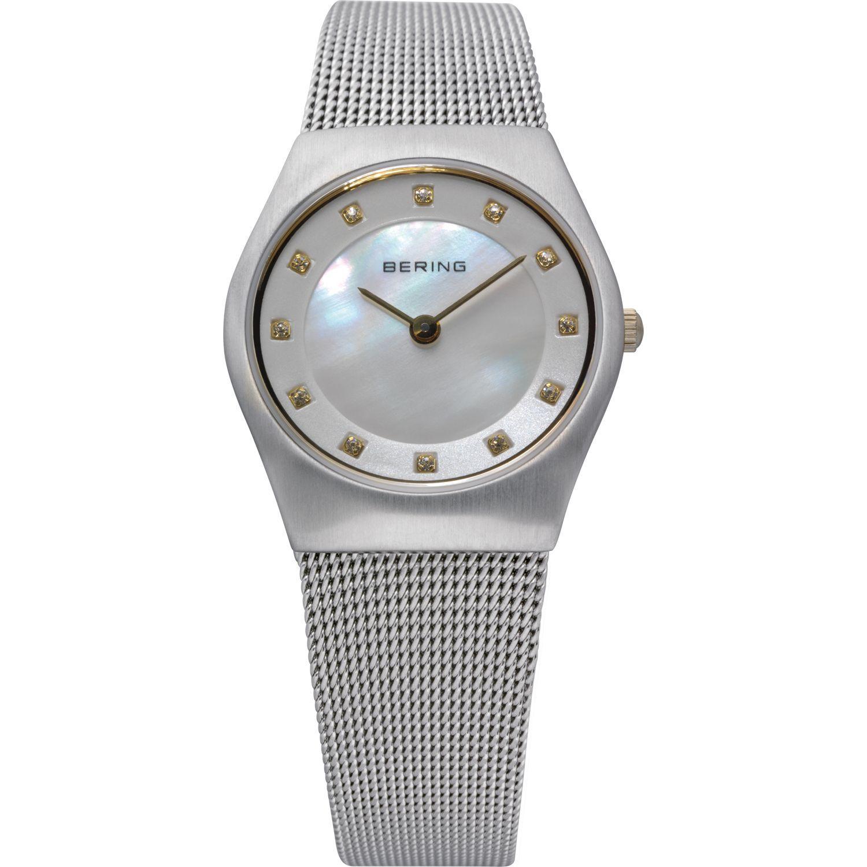 Bering 11927-004 - женские наручные часы из коллекции ClassicBering<br>женские, сапфировое стекло, корпус из нерж. стали,  браслет из нерж. стали, циферблат перламутрового цвета с 12-ю кристаллами swarovski золотого цвета,<br><br>Бренд: Bering<br>Модель: Bering 11927-004<br>Артикул: 11927-004<br>Вариант артикула: ber-11927-004<br>Коллекция: Classic<br>Подколлекция: None<br>Страна: Дания<br>Пол: женские<br>Тип механизма: кварцевые<br>Механизм: None<br>Количество камней: None<br>Автоподзавод: None<br>Источник энергии: от батарейки<br>Срок службы элемента питания: None<br>Дисплей: стрелки<br>Цифры: отсутствуют<br>Водозащита: WR 50<br>Противоударные: None<br>Материал корпуса: нерж. сталь<br>Материал браслета: нерж. сталь<br>Материал безеля: None<br>Стекло: сапфировое<br>Антибликовое покрытие: None<br>Цвет корпуса: серебристый<br>Цвет браслета: серебрянный<br>Цвет циферблата: None<br>Цвет безеля: None<br>Размеры: 27 мм<br>Диаметр: 27 мм<br>Диаметр корпуса: None<br>Толщина: None<br>Ширина ремешка: None<br>Вес: None<br>Спорт-функции: None<br>Подсветка: None<br>Вставка: кристаллы Swarovski<br>Отображение даты: None<br>Хронограф: None<br>Таймер: None<br>Термометр: None<br>Хронометр: None<br>GPS: None<br>Радиосинхронизация: None<br>Барометр: None<br>Скелетон: None<br>Дополнительная информация: None<br>Дополнительные функции: None