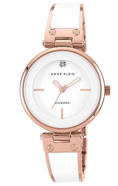 Anne Klein 1414WTRG - женские наручные часы из коллекции DiamondAnne Klein<br><br><br>Бренд: Anne Klein<br>Модель: Anne Klein 1414 WTRG<br>Артикул: 1414WTRG<br>Вариант артикула: None<br>Коллекция: Diamond<br>Подколлекция: None<br>Страна: США<br>Пол: женские<br>Тип механизма: кварцевые<br>Механизм: None<br>Количество камней: None<br>Автоподзавод: None<br>Источник энергии: от батарейки<br>Срок службы элемента питания: None<br>Дисплей: стрелки<br>Цифры: отсутствуют<br>Водозащита: WR 20<br>Противоударные: None<br>Материал корпуса: не указан, PVD покрытие (полное)<br>Материал браслета: не указан, PVD покрытие (частичное)<br>Материал безеля: None<br>Стекло: минеральное<br>Антибликовое покрытие: None<br>Цвет корпуса: None<br>Цвет браслета: None<br>Цвет циферблата: None<br>Цвет безеля: None<br>Размеры: 34 мм<br>Диаметр: None<br>Диаметр корпуса: None<br>Толщина: None<br>Ширина ремешка: None<br>Вес: None<br>Спорт-функции: None<br>Подсветка: None<br>Вставка: бриллиант<br>Отображение даты: None<br>Хронограф: None<br>Таймер: None<br>Термометр: None<br>Хронометр: None<br>GPS: None<br>Радиосинхронизация: None<br>Барометр: None<br>Скелетон: None<br>Дополнительная информация: пластиковые вставки на браслете<br>Дополнительные функции: None