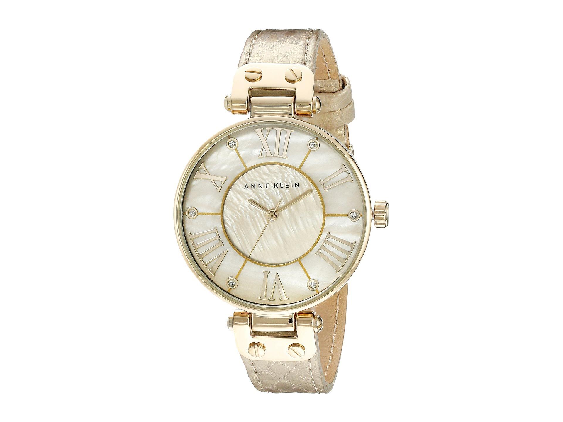 Anne Klein 1012GMGD - женские наручные часы из коллекции RingAnne Klein<br><br><br>Бренд: Anne Klein<br>Модель: Anne Klein 1012 GMGD<br>Артикул: 1012GMGD<br>Вариант артикула: None<br>Коллекция: Ring<br>Подколлекция: None<br>Страна: США<br>Пол: женские<br>Тип механизма: кварцевые<br>Механизм: None<br>Количество камней: None<br>Автоподзавод: None<br>Источник энергии: от батарейки<br>Срок службы элемента питания: None<br>Дисплей: стрелки<br>Цифры: римские<br>Водозащита: WR 30<br>Противоударные: None<br>Материал корпуса: не указан, PVD покрытие: позолота (полное)<br>Материал браслета: кожа<br>Материал безеля: None<br>Стекло: минеральное<br>Антибликовое покрытие: None<br>Цвет корпуса: None<br>Цвет браслета: None<br>Цвет циферблата: None<br>Цвет безеля: None<br>Размеры: 34x9 мм<br>Диаметр: None<br>Диаметр корпуса: None<br>Толщина: None<br>Ширина ремешка: None<br>Вес: None<br>Спорт-функции: None<br>Подсветка: None<br>Вставка: кристаллы Swarovski<br>Отображение даты: None<br>Хронограф: None<br>Таймер: None<br>Термометр: None<br>Хронометр: None<br>GPS: None<br>Радиосинхронизация: None<br>Барометр: None<br>Скелетон: None<br>Дополнительная информация: None<br>Дополнительные функции: None