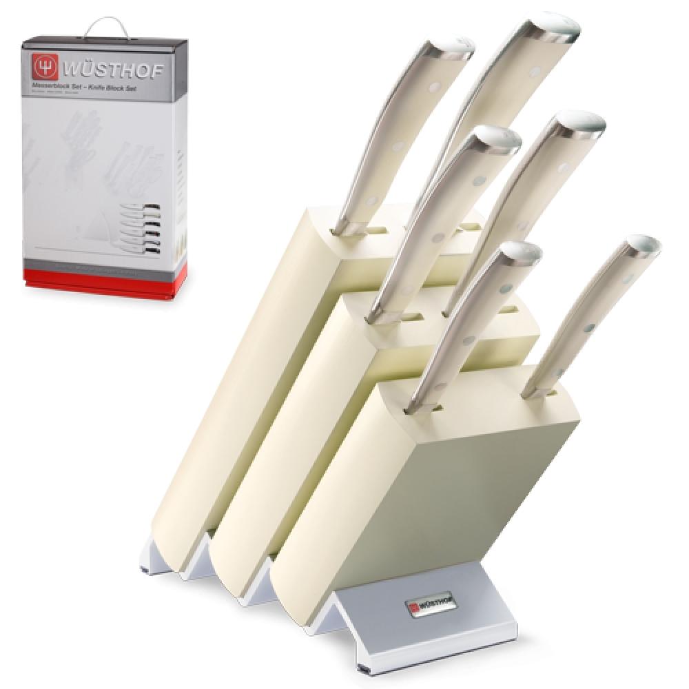 Набор из 6 кухонных ножей и подставки WUSTHOF Ikon Cream White арт. 9877 WUSКухонные ножи WUSTHOF Ikon Cream White<br>Набор из 6кухонных ножей и подставки WUSTHOF Ikon Cream White арт. 9877 WUS<br><br>В набор входит:<br><br>Нож кухонный Шеф 20 см WUSTHOF Ikon Cream White (Золинген) арт. 4596-0/20 WUS<br>Нож кухонный Сантоку 17 см WUSTHOF Ikon Cream White (Золинген) арт. 4176-0 WUS<br>Нож кухонный для хлеба 20 см WUSTHOF Ikon Cream White (Золинген) арт. 4166-0/20 WUS<br>Нож кухонный для томатов 14 см WUSTHOF Ikon Cream White (Золинген) арт. 4126-0 WUS<br>Нож кухонный универсальный 16 см WUSTHOF Classic Ikon (Золинген) арт. 4506/16 WUS<br>Нож кухонный овощной 9 см WUSTHOF Ikon Cream White (Золинген) арт. 4086-0/09 WUS<br>Деревянная подставка<br><br>Отличительные особенности<br>Что резать: <br><br>Нож Шеф - подходит для нарезки любых продуктов (мясо, рыба, овощи, фрукты).<br>Нож Сантоку- подходит для нарезки любых продуктов (мясо, рыба, овощи, фрукты).<br>Нож для хлеба -хлеб и продукты с твердой коркой и мягкой серединой (ананас, арбуз, дыня и т.д.).<br>Нож для томатов -подходит для нарезки хлеба и продуктов с твердой коркой и мягкой серединой (томаты, киви и т.д.).<br>Нож универсальный -подходит для нарезки не больших кусков мяса и рыбы, а также сыра, овощей и фруктов.<br>Нож овощной -подходит чистки для нарезки овощей и фруктов.<br><br>Материал лезвия: сталь кованая, молибден-ванадиевая (X50 Cr Mo V 15) - отличается высочайшим уровнем прочности, обеспечивающимся наличием молибдена и ванадия в ее составе. Оптимальная для ножей твердость лезвия объясняется повышенным содержанием углерода в составе металла и особой технологией его термообработки. Сталь X50CrMoV15 благодаря наличию в ее составе хрома, отличается также повышенной стойкостью к коррозии.<br>Лезвия ножей из стали марки X50CrMoV15 долгое время не нуждаются в дополнительной заточке, они не темнеют и практически не подвержены окислению. Вне зависимости от интенсивности эксплуатации ножи сохраняют свой первоздан
