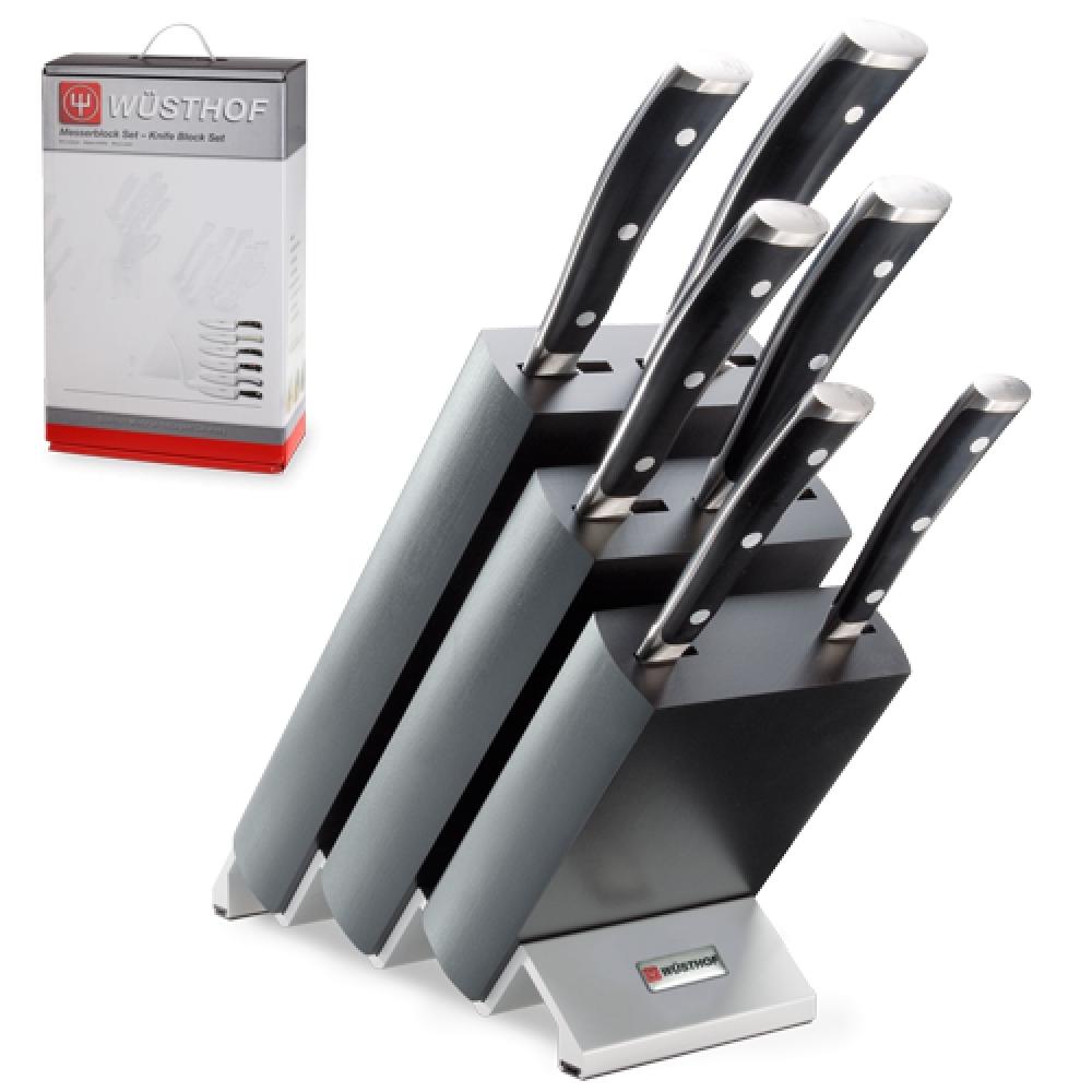 Набор из 6 кухонных ножей и подставки WUSTHOF Classic Ikon арт. 9876 WUSКухонные ножи WUSTHOF Classic Ikon<br>Набор из 6кухонных ножей и подставки WUSTHOF Classic Ikon арт. 9876 WUS<br><br>В набор входит:<br><br>Нож кухонный овощной 9 см WUSTHOF Classic Ikon (Золинген) арт. 4086/09 WUS<br>Нож кухонный для томатов 14 см WUSTHOF Classic Ikon (Золинген) арт. 4126 WUS<br>Нож кухонный для хлеба 20 см WUSTHOF Classic Ikon (Золинген) арт. 4166/20 WUS<br>Нож кухонный Сантоку 17 см WUSTHOF Classic Ikon (Золинген) арт. 4176 WUS<br>Нож кухонный для нарезки 16 см WUSTHOF Classic Ikon (Золинген) арт. 4506/16 WUS<br>Нож кухонный Шеф 20 см WUSTHOF Classic Ikon (Золинген) арт. 4596/20 WUS<br>Деревянная подставка<br><br>Отличительные особенности<br>Что резать: <br><br>Нож Шеф - подходит для нарезки любых продуктов (мясо, рыба, овощи, фрукты).<br>Нож Сантоку - подходит для нарезки любых продуктов (мясо, рыба, овощи, фрукты).<br>Нож для нарезки -подходит для нарезки мясного и рыбного филе, а также японских блюд.<br>Нож для хлеба -хлеб и продукты с твердой коркой и мягкой серединой (ананас, арбуз, дыня и т.д.).<br>Нож для томатов -подходит для нарезки хлеба и продуктов с твердой коркой и мягкой серединой (томаты, киви и т.д.).<br>Нож овощной -подходит чистки для нарезки овощей и фруктов.<br><br>Материал лезвия: сталь кованая, молибден-ванадиевая (X50 Cr Mo V 15) - отличается высочайшим уровнем прочности, обеспечивающимся наличием молибдена и ванадия в ее составе. Оптимальная для ножей твердость лезвия объясняется повышенным содержанием углерода в составе металла и особой технологией его термообработки. Сталь X50CrMoV15 благодаря наличию в ее составе хрома, отличается также повышенной стойкостью к коррозии.<br>Лезвия ножей из стали марки X50CrMoV15 долгое время не нуждаются в дополнительной заточке, они не темнеют и практически не подвержены окислению. Вне зависимости от интенсивности эксплуатации ножи сохраняют свой первозданный вид на протяжении всего срока их использования.<br>Матери