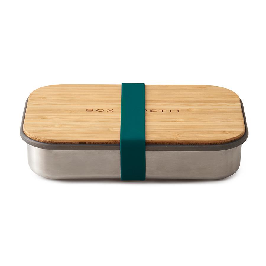 Сэндвич-бокс Black+Blum бирюзовый BAM-SB005Ланч-боксы<br>Удобная коробка для сэндвичей из нержавеющей стали, дополненная бамбуковой крышкой и силиконовой лентой бирюзового цвета. <br><br>Коробка подходит для хранения как уже готовых сэндвичей, так и отдельных продуктов, входящих в их состав. Антибактериальные свойства бамбука позволяют использовать крышку коробки в качестве разделочной доски, на которой блюдо можно приготовить непосредственно перед подачей. Нержавеющая сталь, из которой выполнен корпус бокса, сохранит свой внешний вид даже в сложных условиях эксплуатации. А силиконовая лента-перетяжка герметично зафиксирует крышку на корпусе. Она легко моется и также очень долговечна.<br><br>Сэндвич-бокс Black&amp;#43,Blum – удобное решение для тех, кто покупным предпочитает свежие сэндвичи из-под ножа. Самые оригинальные ингредиенты теперь можно взять с собой и приготовить изысканный деликатес в любом удобном месте: в офисе, школе, университете или прямо на траве во время пикника.<br>Красивый и стильный он выделит своего обладателя из толпы и покажет его как человека, разбирающегося в хорошем дизайне. <br>Основой же этих преимуществ станет высокое качество материалов, благодаря которому сэндвич-бокс прослужит долгие годы.<br>