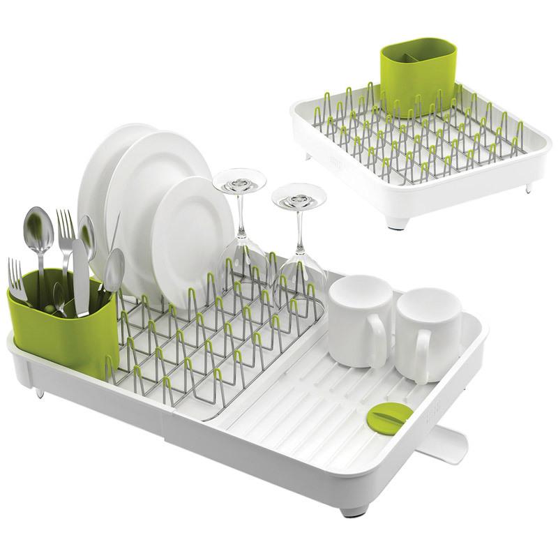 Сушилка для посуды раздвижная Joseph Joseph extend белая 85071Сушилки для посуды<br>Сушилка для посуды раздвижная Joseph Joseph extend белая 85071<br><br>Все кухни в домах разные, но проблема одна: не хватает места для самого необходимого. С умными решениями от Joseph Joseph можно запросто экономить пространство. Раздвижная сушилка для посуды разбирается ровно в два раза, в зависимости от количества тарелок и чашек, которые вам необходимо просушить прямо сейчас. С помощью специального поворотного носика вы можете регулировать слив лишней воды прямо в раковину. Этому так же способствуют ребра на дне сушилки и уклон поверхности. Металлические стойки с мягкими наконечниками бережно удерживают тарелки, защищая их от царапин, а столовые приборы ловко помещаются в специальный стакан.<br>Официальный продавец<br>