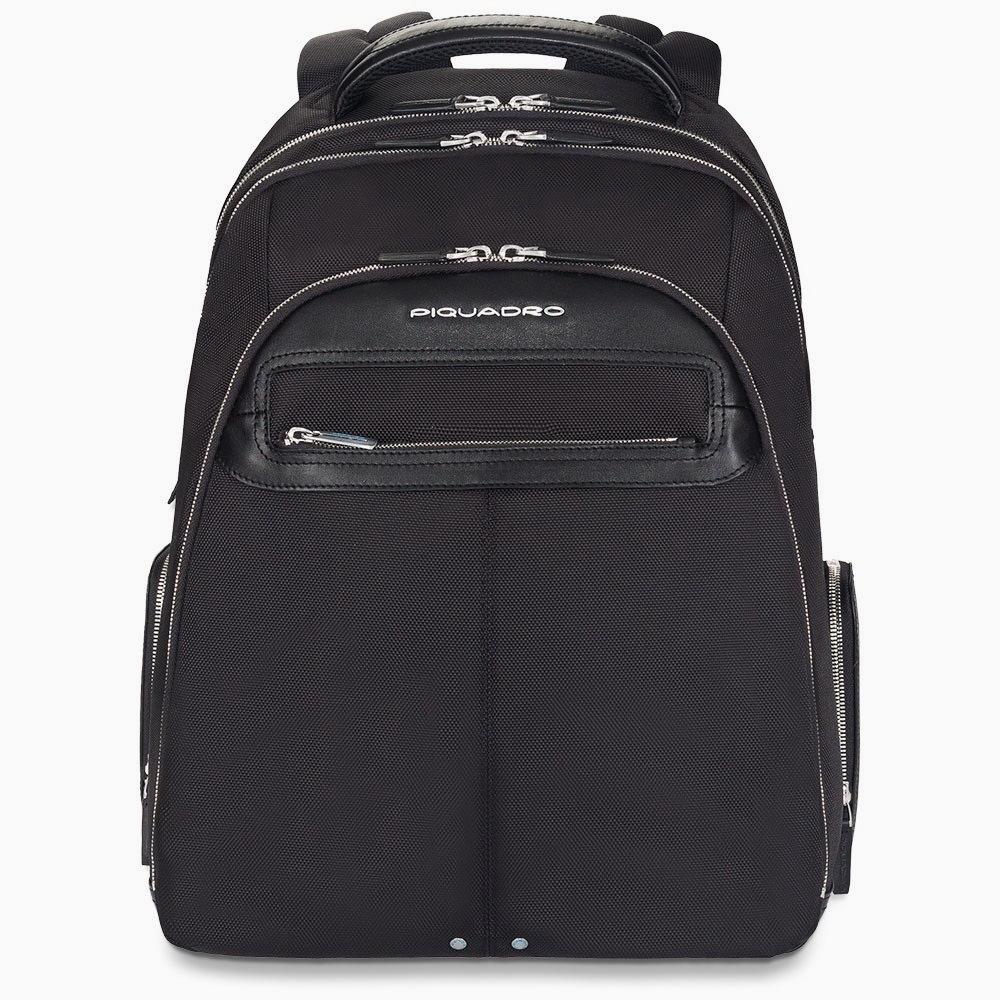 Рюкзак Piquadro Link, цвет черный, 36х48х24,5 см (CA1813LK/N)Рюкзаки<br>Видео:Коллекция «Link»от PIQUADRO.Видео: БрендPIQUADRO<br>Коллекция PiquadroLink характеризуется сочетаниемводостойкой синтетической ткани и ценной зернистой кожи теленка, мягкой и теплой на ощупь. Кожа для изделий коллекции Link подвергается специальному процессу обработки, который увеличивает ее мягкость и добавляет приятных ощущений от прикосновений к такому материалу. После этого кожа тщательным образом полируется с использованием анилина, что придает изделиям исключительную полноту цвета и блеск.<br>Просторный деловой мужской рюкзак с отделением для ноутбука на молнии из коллекции Link содержит три основных отдела на молнии, специальное отделение для ноутбука с экраном до 15 и для планшета с мягкими стенками, внутренний карман для телефона, держатели для ручек, съемный держатель для ключей, шесть слотов для банковских и дисконтных карт. Также имеются дополнительные внешние карманы на молнии спереди и по бокам рюкзака для мелких вещей.<br><br>Видео: Коллекция «Link» от PIQUADRO.<br><br>Видео: БрендPIQUADRO<br>