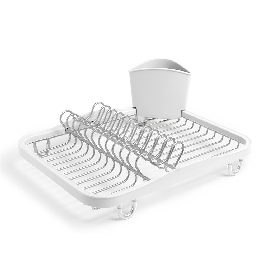 Сушилка для посуды Umbra SINKIN белый/никель 330065-670Сушилки для посуды<br>Сушилка для посуды Umbra SINKIN белый/никель 330065-670<br><br>Функциональная сушилка Sinkin в новой цветовой вариации. Предусмотрены отсеки для тарелок и чашек. Съемный пластиковый контейнер удобен для сушки столовых приборов. Благодаря специальным ножкам вода стекает в раковину, не застаиваясь под посудой. Пластиковые насадки на ножках оберегают раковину от царапин. Металлическая решетка и пластиковое обрамление легко очищаются от загрязнений.  Дизайн: Helen T. Miller<br>Официальный продавец<br>