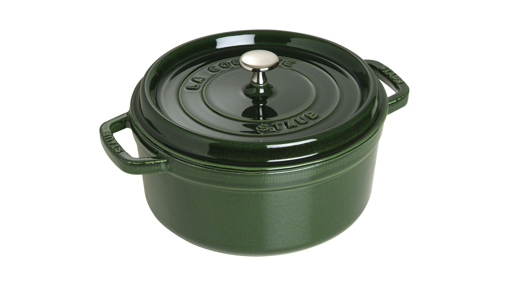 Кокот Staub круглый, 24 см, 3,8 л, зеленый базилик 1102485Новинки<br>Кокот Staub круглый, 24 см, 3,8 л, зеленый базилик 1102485<br><br>Эмалированный чугун – это сплав обогащенного углем железа, покрытого эмалью, изготовленной на основе стекла. Это один из самых лучших материалов, который не только удерживает тепло, но и сохраняет холод.<br>Каждое изделие имеет свои особенности и нюансы, поскольку отливается в индивидуальных формах из песка, которые разрушаются после каждого использования, эти неровности ни в коем случае нельзя воспринимать, как недостатки!<br>Отличительные особенности Staub:<br><br>Декоративная латунная или никелевая ручка может использоваться в духовке до 200°С.<br>Внешнее покрытие – 2 слоя эмали, чугун, внутреннее покрытие 2-слоя черной эмали.<br>Пригодна для мытья в посудомоечной машине.<br>Подходит для всех типов плит.<br>Можно использовать в духовке, кроме посуды с деревянной ручкой.<br><br>Рекомендации по уходу за посудой:<br><br>Промойте Вашу посуду в теплой воде, дайте ей высохнуть. Смажьте внутреннюю поверхность кастрюли растительным маслом. Прогрейте ее в течение нескольких минут на медленном огне, а затем удалите остатки масла. Ваша посуда готова к использованию!<br>Кастрюля должна нагреваться постепенно ( так как эмалированный чугун можно использовать на индукционных варочных поверхностях, ВАЖНО при предварительным нагревании использовать треть мощности плиты в течении 5-7 минут).<br>Подберите величину конфорки соответствующей размеру дна Вашей посуды.<br>Используйте лопатки из силикона или дерева.<br>Не заливать горячую кастрюлю холодной водой.<br>Объем, указаны до края кокота. <br><br>При падении на твердую поверхность посуда может треснуть или разбиться. Металлические кухонные принадлежности могут повредить посуду. Избегать резкого нагревания и охлаждения, резкий перепад температуры может привести к повреждению посуды. Чтобы не обжечься, пользуйтесь прихватками.<br>Изготовитель: Zwilling Staub France S.A.S, 47 bis, rue des Vinaigriers