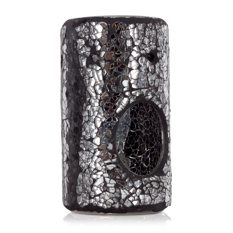 Лампа Черная магия (Масляные аромалампы-горелки)Масляные аромалампы-горелки<br>Dark Magic (Черная магия) - Масляная лампа из мозаики A&amp;B в форме колонны «Черная магия».<br>Эта смелая масляная лампа в форме колонны украшена перемежающимися секциями сверкающего серебра и блестящих кусочков мозаики черного цвета.<br><br>Информация по использованию масляных ламп:<br><br>Добавьте несколько капель выбранного вами ароматического масла Ashleigh &amp; Burwood в чашу горелки и добавьте воды.<br>Поставьте невысокую свечку в лампу под чашу горелки.<br>Осторожно зажгите свечку, и пламя нагреет чашу, наполняя комнату прекрасным ароматом.<br><br><br>Не применяйте масло без добавления воды! Нарушение правил использования может привести к брызгам, задымлению или возгоранию.<br>