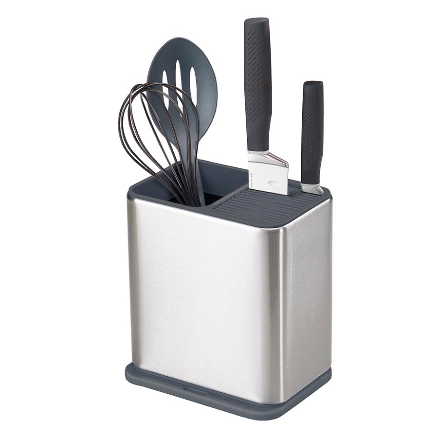 Органайзер для кухонной утвари и ножей Joseph Joseph Surface из нержавеющей стали 85114Подставки для ножей с наполнителем<br>Органайзер для кухонной утвари и ножей Joseph Joseph Surface из нержавеющей стали 85114<br><br>Великолепный органайзер для хранения лопаток, половников, поварских ложек и ножей. Основное отделение разбито на сегменты, что обеспечивает максимальную вместительность. Отдельно предусмотрен отсек для ножей. В основание контейнера встроена съемная подставка, на которую удобно класть грязную ложку во время приготовления пищи. Органайзер просто разбирается и легко моется. Нескользящие ножки обеспечивают хорошую устойчивость на любой поверхности.<br>Коллекция Surface - современное решение для организации рабочего пространства кухни. Все предметы коллекции изготовлены из стали класса SS430, хорошо известной своими высочайшими антикоррозийными свойствами.<br>