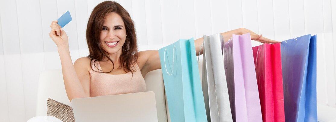 Smiling_Female_Shopping_Online.jpg