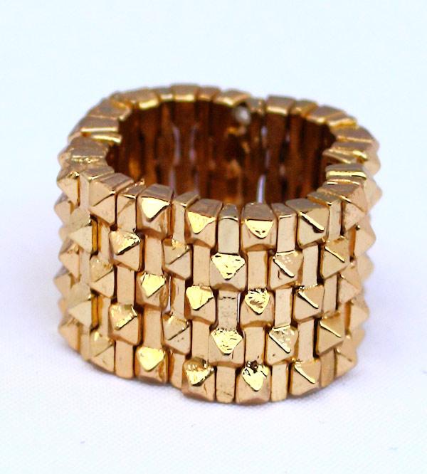 Эластичное женское кольцо золотого цвета (безразмерное) фото