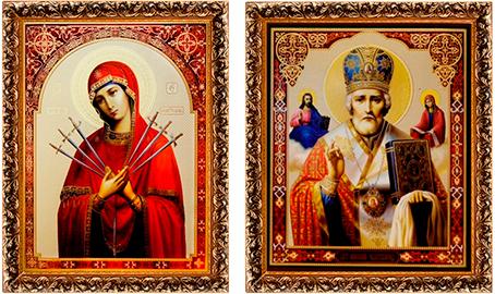 Иконы святых в деревянной раме