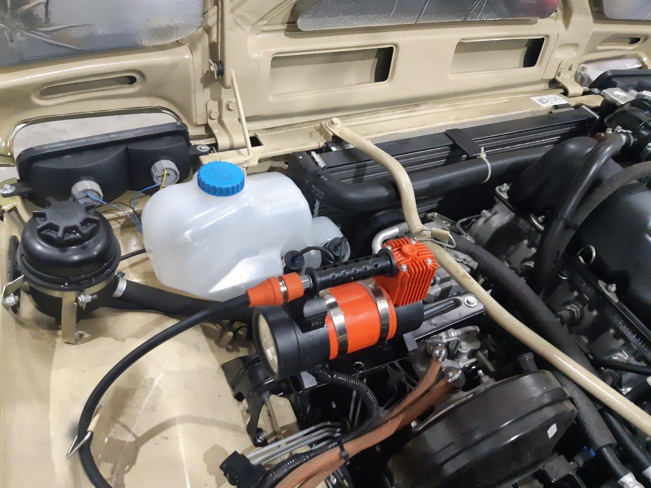 размещение компрессора и дополнительного бачка омывателя в Ниве