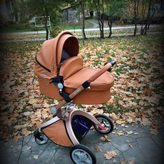 Классические или поворотные колеса у коляски: что выбрать?