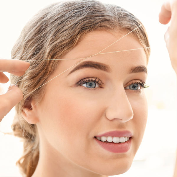 Тридинг: коррекция бровей нитью