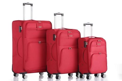 Красные тканевые чемоданы