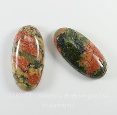 Каменные кабошоны из Унакита