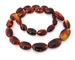 бусы оливки средние из янтаря с эффектом пламени