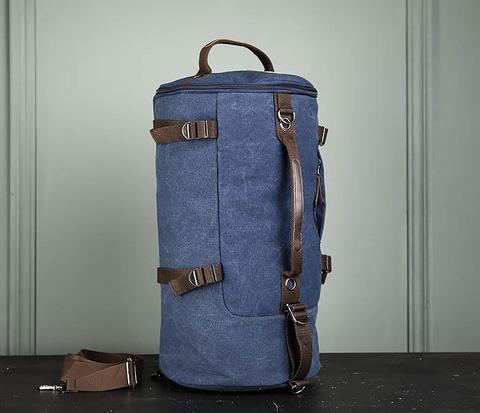 Вместительная мужская сумка -рюкзак из ткани синего цвета