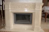 Каминный портал из мрамора Крема Марфил с декоративными элементами  Арт 005