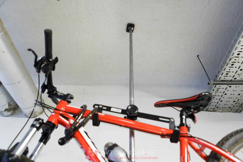 Телескопическая распорка для подвеса велосипедов