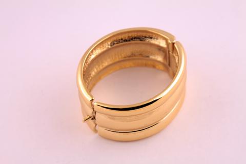 Золотой браслет от Yves Saint Laurent