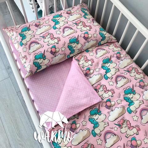 Дитяча постіль з рожевими єдинорогами фото