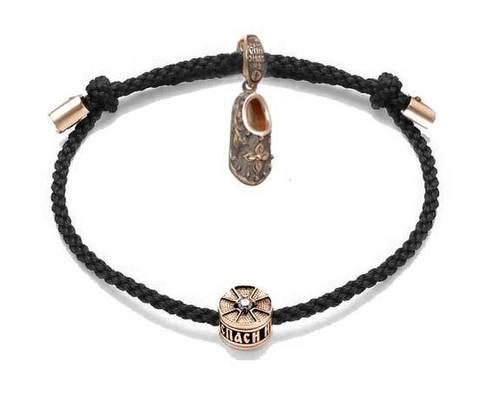 Черный браслет с позолоченным тапочком Спиридона и бусиной