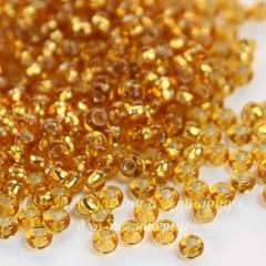 Бисер 10/0 Preciosa прозрачный с серебряным центром, оранжево-золотой