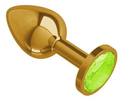Золотистая конусовидная анальная пробка с салатовым кристаллом - 7 см.