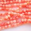 Бусина Коралл, шарик с огранкой, цвет - розовый, 4 мм, нить (крупнее светлее)
