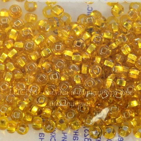 87060 Бисер 10/0 Preciosa прозрачный желто-оранжевый с серебряным квадратным центром