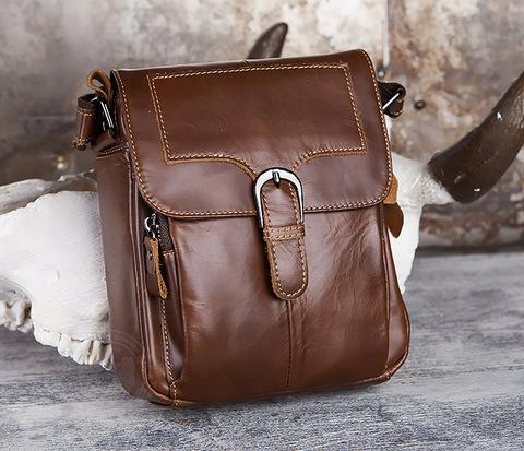 Небольшая кожаная сумка с ремнем на плечо