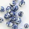 """Бусина фарфоровая овальная ручной работы """"Синий рисунок на белом фоне"""", 10х8 мм"""