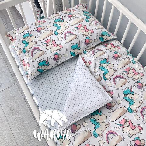 Дитяча постіль з білими єдинорогами фото