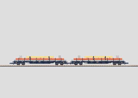 Набор из 2-х четырехосных платформ с грузом MARKLIN 82580