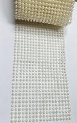 Лента полужемчужная 18 рядов, ширина 12 см, диаметр 6 мм, цена за 50 см.