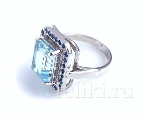 кольцо серебряное с голубым топазом 8*10 мм