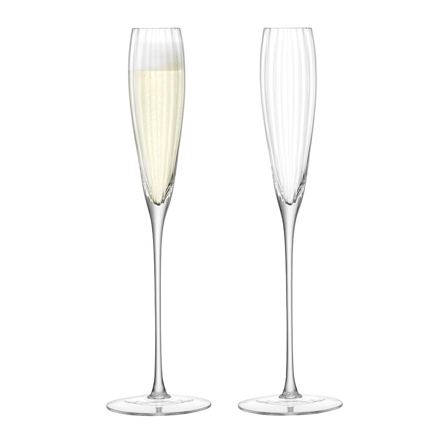 Набор из 2 бокалов-флейт для шампанского Aurelia LSA G874-06-776Бокалы и стаканы<br>Добавьте изысканности вашей сервировке с классическими бокалами-флейтами для шампанского Aurelia. Комбинируйте их с бокалами для белого и красного вина, и стаканами для воды, чтобы создать завершенную композицию. Бокалы упакованы в стильную коробку, поэтому станут отличным подарком. Набор состоит из 2-х бокалов. Объём каждого бокала 165 мл.<br><br>Предметы коллекции Aurelia выполнены из прозрачного выдувного стекла. Особенности коллекции — тонкие грани, создающие необычный оптический эффект за счёт игры света, и удлинённые тонкие ножки бокалов. Изысканная и утончённая Aurelia — идеальный выбор для торжественных и официальных мероприятий.<br><br>Изделия из выдувного стекла рекомендуется мыть вручную в тёплой мыльной воде и вытирать насухо мягкой тканью. Иногда в готовом изделии из выдувного стекла встречаются пузырьки воздуха — это нормально и вполне допускается технологией ручного производства. Такие пузырьки воздуха внутри не являются браком.<br>