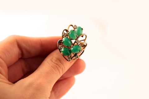 Оригинальное серебряное кольцо с зелеными кабошонами от Panetta
