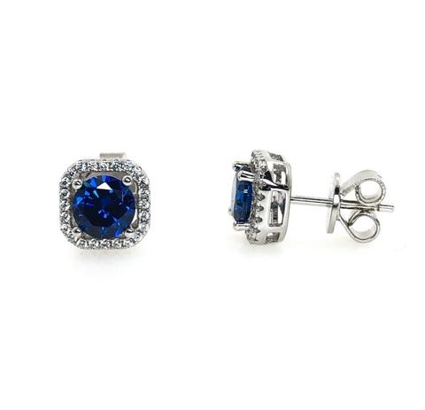 Серьги гвоздики из серебра с синими цирконами