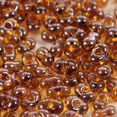 16090/ Бисер Preciosa Фарфаль (Farfalle) 6,5х3,2 мм прозрачный блестящий янтарно-коричневый