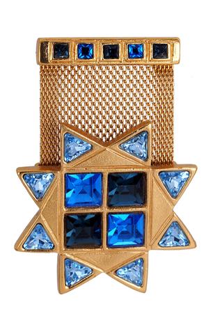 Брошь Yves Saint Laurent в геральдическом стиле