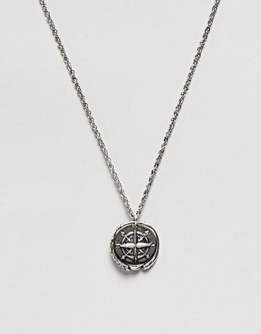 Серебристое ожерелье с подвеской в виде компаса