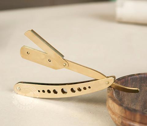 Опасная бритва (шаветка) со сменными лезвиями золотого цвета