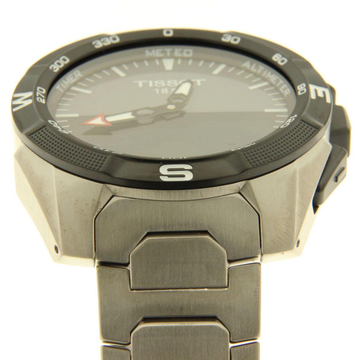Часы tissot t touch expert