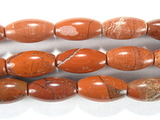 Нить бусин из яшмы красной, фигурные, 6x12 мм (овал, гладкая)